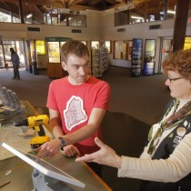Nate Wildes demonstrates the Live and Work in Maine iPad at the Kittery Visitor Center